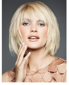 I like the cut if i was considering going short. I like the texturizing and the color. I also like her makeup.