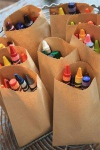 crayons in kraft bags for kids at the wedding reception.