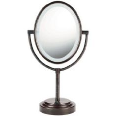 """Imagine this elegant 7"""" x 9.5"""" oval design Mirror setting on your vanity.  It has an Oiled-Bronze Finish.  Soft halo lighting for clear, fog-free viewing.  This has a Cord so you don't have to buy batteries.  This is a very popular Vanity Makeup Mirror and is modestly priced!"""