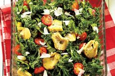 Mediterranean Kale Salad - Marinating the kale helps soften it while adding flavour. Use a vegetable peeler to shave the cheese for this colourful salad.