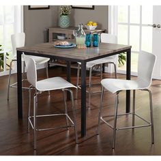 Offer your guests a modern dining experience with this five-piece table and stool set. Made from MDF wood, laminate and metal, this counter height table features a grey, reclaimed-look finish and sits