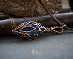 lapis lazuli bronze wire wrapped pendant