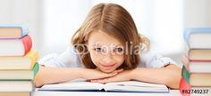 """Laden Sie das lizenzfreie Foto """"pretty girl with many books at school"""" von Syda Productions zum günstigen Preis auf Fotolia.com herunter. Stöbern Sie in unserer Bilddatenbank und finden Sie schnell das perfekte Stockfoto für Ihr Marketing-Projekt!"""