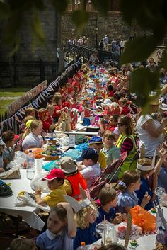 Nothing like seeing it all in action! Mad Hatters Tea Party with hundreds of children around the Cathedral, Winchester - we love bunting and parties!!