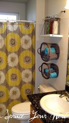 towel holders, wall-mounted baskets. Gray and yellow bathroom.