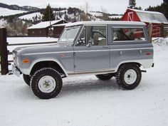 old bronco out in the snow