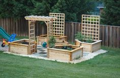 I like the arbor and trellis' added to this raised vegetable bed design.  I would make a strawberry tower in the middle.  DSC_7587.jpg