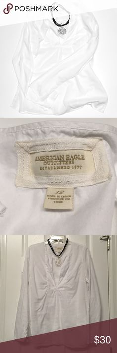 American Eagle Outfitter Shirt American Eagle Outfitter Shirt. Size 12. EUC. Tiny little pink spot in front (shown in last picture). Cute split on each side of the shirt (as shown in the photo) and on the bottom of each sleeve. American Eagle Outfitters Tops