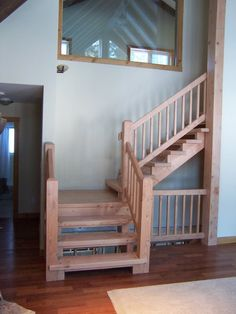 Douglas Fir Stairs in open concept cottage  www.gregbrownconstruction.com