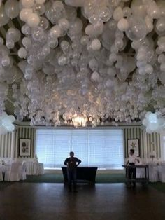Balloon ceiling, how pretty!   (To get the balloons to hang upside down, place a marble in them before blowing them up.)