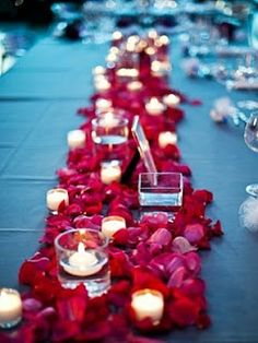 Centrepiece idea. Love scattered petals with candles. http://realflowerpetalconfetti.blogspot.co.uk/2012_08_01_archive.html