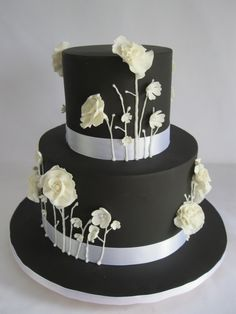 Black cake with white blooms