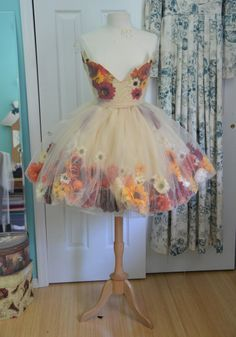 Artificial flowers glues to organza 3/4 circle skirt. Covered in double layer tulle bubble skirt.
