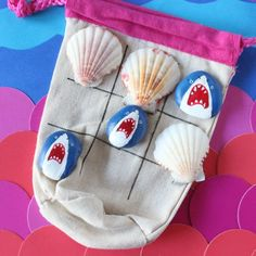Paint rocks like a shark, and get out your favorite shells to play a fun game of…