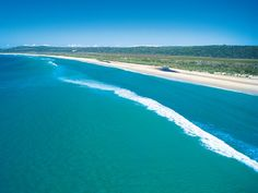 Carnival CEO Ann Sherry loves Main Beach on Stradbroke Island in Queensland for its great surf and crystal clear water. Picture: Queensland Tourism