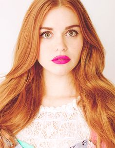 Holland Roden - Not entirely sure how pink lips with red hair works but somehow it does