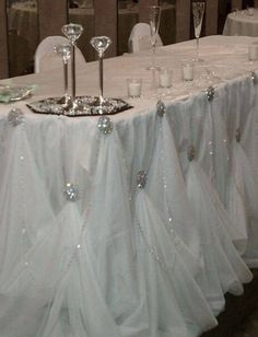 I LOVE this for a head table front. Easy, blingy, and beautiful. tulle head table.jpg