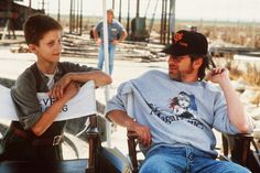 Spielberg on set of Empire of the Sun with baby Christian Bale