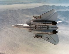 """Underside view of a Grumman F-14 """"Tomcat"""" carrying four AIM-54 Phoenix missiles along with AIM-7 Sparrow and AIM-9 Sidewinder missiles. by aeroman3, via Flickr"""