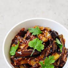 Szechuan Eggplant with Eggplant, Shallots, Minced Garlic, Chilli Sauce, Soya Sauce, White Vinegar, Cornflour, Brown Sugar, Coriander Leaves, Black Pepper, Sesame Oil, Water.