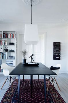 the richness of the rug juxtaposed with the spareness of the room