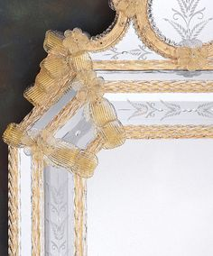Magnificent hand-crafted Venetian wall mirror framed in hand etched glass with gold accents