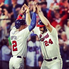 Gattis and Upton celebrate after El Oso Blanco blasts a two-run home run in the 8th!