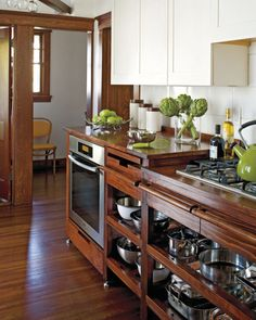 warm white upper cabinets, wood lower cabinets