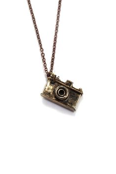 I love long simple necklaces like this, especially the dark vintage gold