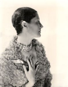 Singer Sewing Machine Heiress, Daisy Fellowes, by Cecil Beaton bromide print, 1930s, wearing her pair of Boivin Diamond and Sapphire Pigeon Wing Brooches.