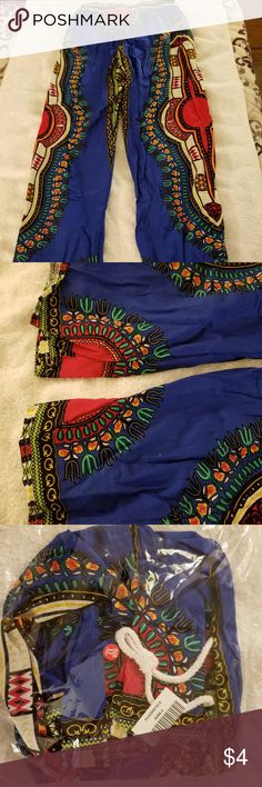 Women's Dashiki Bohemian lounge pants These pants are brand new and still in the bag. They were given to me as a gift and they are WAY too small. The size is XL, but they fit like a small. Elastic waist is 11.5 inches across, the inseam is 25 inches. They have an elastic drawstring band and no pockets.    These pants come from a smoking home with a cat and a non shedding Shih Tzu.   All proceeds will be going towards my momma's health care.  Thank you for stopping by 😀 Dashiki Pants Wide…