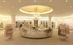 The commercial benefits of good lighting in a retail environment cannot be underestimated – although they are often difficult to quantify Lingerie Store Design, Store Layout, Cool Lighting, Display Lighting, Chandelier, Ceiling Lights, Table Decorations, Projects, Furniture