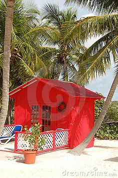 What's even better than a little house on the beach? A red one!