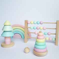 Handmade with love and hand painted with acrylic, non toxic, child friendly paints our happy tree stacker fits perfect to each nursery.Made of beech wood. Pastel Nursery, Rainbow Nursery Decor, Stacking Toys, Montessori Toys, Sensory Toys, Freundlich, Wood Toys, Diy Toys, Toddler Toys