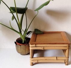 Vintage small bamboo plant stand, with some beautiful age and character.  Perfect on a table or mantelpiece or shelf, or on the floor perhaps, it measures 25 cm wide by 15.5 cm.  It weighs 836 g.