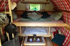 Wowo Glamping, Wapsbourne Manor Organic Farm, East Sussex. The small wood stove is bejewelled with all the vintage crocs, cutlery, pots and pans you will need, keeping the wagons authentic feel http://www.organicholidays.com/at/3184.htm