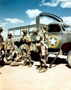 US Paratroopers of the 82nd Airborne preparing for a jump, North Africa, 1942. Note CCKW 2 ½-ton 6x6 transport truck