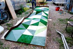 Faceted mini golf hole idea. Maybe there is a way to make this into a mountain range for our ski town Putt & Pub Crawl.