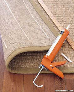 From Martha Stewart: rather than buying expensive anti-slip mats for a rug, just turn it over and run a few lines of acrylic-latex caulk every 6 inches or so. Let dry and flip over...rug will stay in place.
