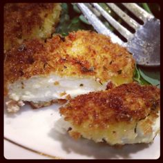 Crispy fried goat cheese. Add more spices to breading. Serve with tomatoes