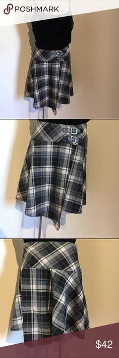 Bebe plaid skirt Dark grey and black plaid skirt with asymmetrical hem and leather buckles at waist. bebe Skirts Mini