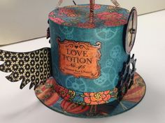 Great altered top hat from Cristi Maron shared on our Ning gallery #graphic45 #alteredart