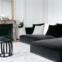 #2 Moulding, dark grey velvet sofa with grey and blue toss cushions, cream coloured rug