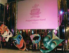 Mardi Gras themed Corporate Event: masks and Mylar ribbon. J Patrick Designs