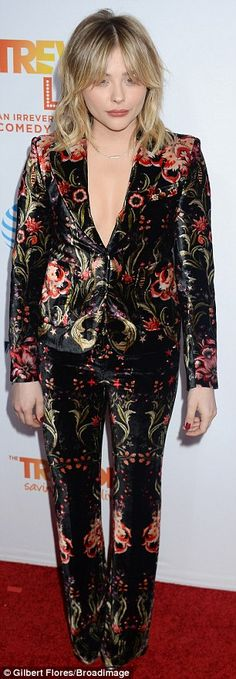 Seventies vibes:The actress looked gorgeous in her bold floral bloom suit and edgy hair d...