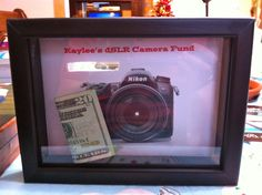 Smart way to save for something specific! Use a shadow box with a picture of what the money will be going towards.