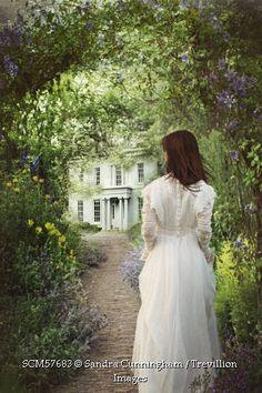 Trevillion Images - edwardian-woman-walking-in-garden