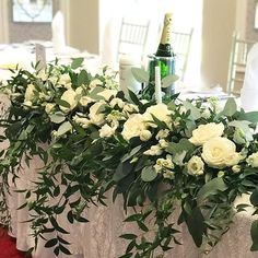 Top table in ivory and green at @viennawoodshotel #toptsble #weddingflowers #weddingtable #ivorywedding #corkwedding #irishwedding #irishflorist #bloomsdayflowers