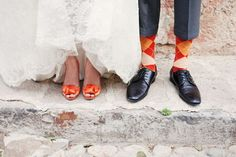 How cute, the #bride and #groom match a stunning tangerine color with their socks and shoes!