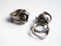 """uptomuch - """"Bud with Guards - set of 3d printed rings in stainless steel"""""""
